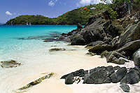 Coral sand beaches and clear, blue waters at Hawksnest Beach on the island of St John in the US Virgin Islands