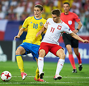 Lublin, Poland - 2017 June 19: (L) Pawel Cibicki from Sweden U21 fights for the ball with (R) Przemyslaw Frankowski from Poland U21 while Poland v Sweden match during 2017 UEFA European Under-21 Championship at Lublin Arena on June 19, 2017 in Lublin, Poland.<br /> <br /> Mandatory credit:<br /> Photo by &copy; Adam Nurkiewicz / Mediasport<br /> <br /> Adam Nurkiewicz declares that he has no rights to the image of people at the photographs of his authorship.<br /> <br /> Picture also available in RAW (NEF) or TIFF format on special request.<br /> <br /> Any editorial, commercial or promotional use requires written permission from the author of image.