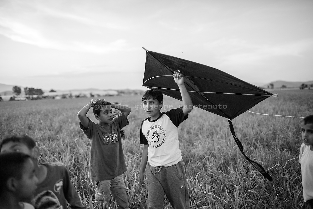 17 April 2016, Greece, Idomeni - Children play with kite inside the refugees camp of Idomeni.