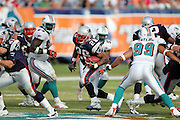 MIAMI - DECEMBER 10:  Running back Corey Dillon #28 of the New England Patriots runs the ball in traffic against the Miami Dolphins at Dolphin Stadium on December 10, 2006 in Miami, Florida. The Dolphins defeated the Patriots 21-0. ©Paul Anthony Spinelli *** Local Caption *** Corey Dillon