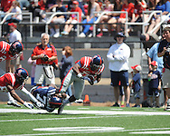 Mark Dodson (7) is tackled by Trae Elston (7) at Ole Miss' Grove Bowl at Vaught-Hemingway Stadium in Oxford, Miss. on Saturday, April 13, 2013.