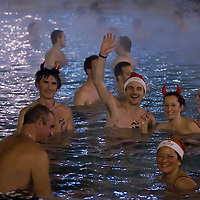 """Participants of the half naked """"Santa run"""" enjoy the 38 degree celsius thermal pool of Szechenyi bath in Budapest, Hungary on December 11, 2011. ATTILA VOLGYI"""