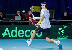 Janez Semrajc of Slovenia (white) plays against Joao Sousa of Portugal (red) during 1st match of Davis cup Slovenia vs. Portugal on January 31, 2014 in Kranj, Slovenia. Photo by Vid Ponikvar / Sportida
