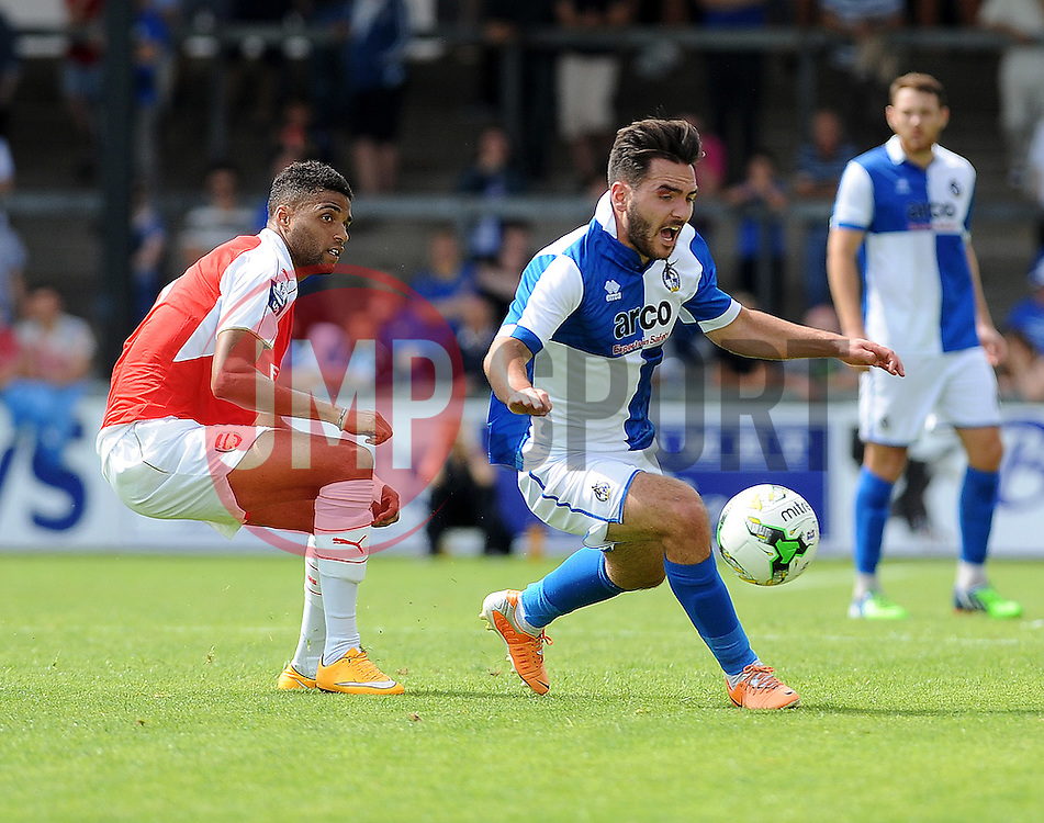Jake Gosling of Bristol Rovers is challenged by Arsenal's Kristopher Da Garcia - Photo mandatory by-line: Neil Brookman/JMP - Mobile: 07966 386802 - 18/07/2015 - SPORT - Football - Bristol - Memorial Stadium - Pre-Season Friendly