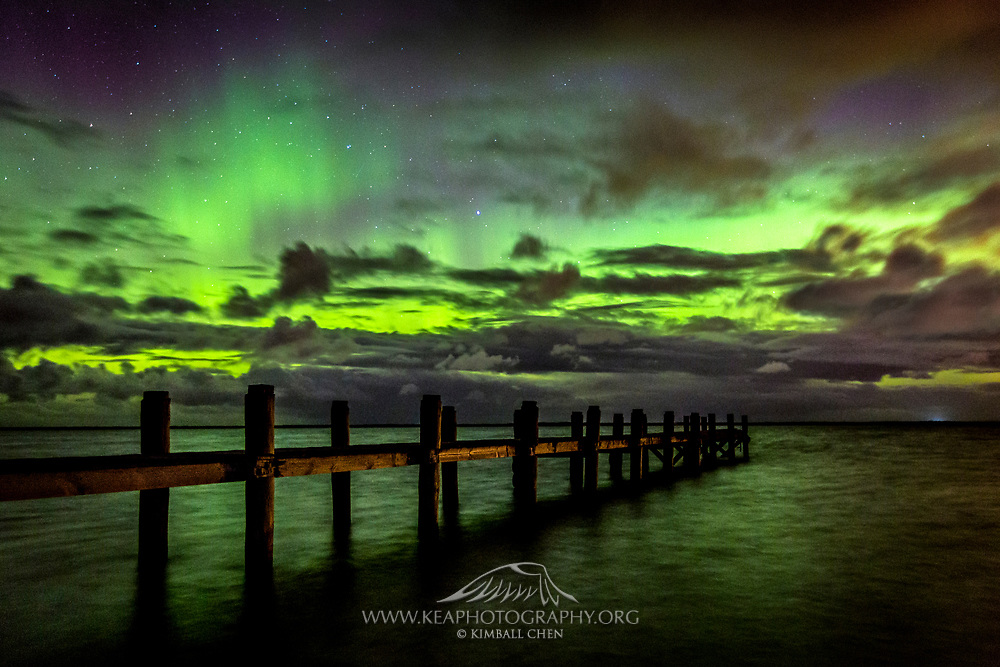 St Patricks week in 2015 was full of multiple nights of fantastic displays from the Aurora Australis.   Here at Awarua Bay in Southland, New Zealand, a green glow emanates behind the moody clouds.