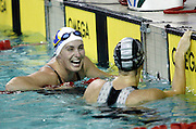 Alison Fitch shares a laugh with team mate Nichola Chellingworth after coming second to Chellingworth during the Womans 50m  on day one of the 2006 New Zealand Youth and Open Swimming Championships at QEII Leisure Centre, Christchurch on Wednesday 12 April 2006. Photo: Simon Fergusson/PHOTOSPORT<br /> <br /> <br /> 120406