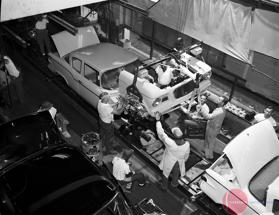 A 1960 Studebaker Lark receives its front-end sheet metal at the company's South Bend, Indiana plant.