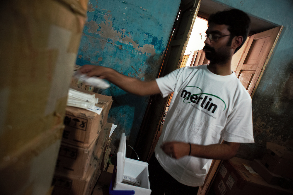 A Merlin pharmacutical assistant checks stocks at the supply depot facility in Dadu, Sindh, Pakistan on July 5, 2011.