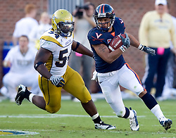 Virginia running back Mikell Simpson (5) turns the corner past Georgia Tech LS Michael Ray (54).  The Virginia Cavaliers defeated the #18 ranked Georgia Tech Yellow Jackets 24-17 in NCAA Division 1 Football at Bobby Dodd Stadium on the campus of Georgia Tech in Atlanta, GA on October 25, 2008.