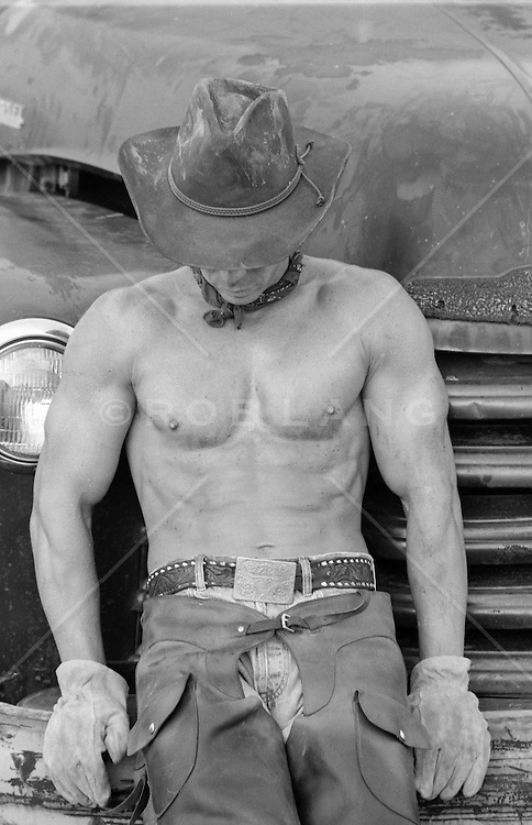 shirtless All American cowboy outdoors shirtless muscular cowboy on a ranch