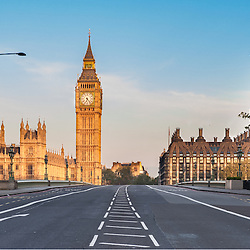 Empty Westminster Bridge and the Houses of Parliament with the Big Ben in London on a early summer morning.