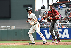 April 11, 2018 - San Francisco, CA, U.S. - SAN FRANCISCO, CA - APRIL 11: San Francisco Giants Starting Pitcher Andrew Suarez (59) leads off from first base after a hit by San Francisco Giants Center field Austin Jackson (16) during the game between the Arizona Diamondbacks and the San Francisco Giants on Wednesday, April 11, 2018 at AT&T Park in San Francisco, CA (Photo by Douglas Stringer/Icon Sportswire) (Credit Image: © Douglas Stringer/Icon SMI via ZUMA Press)