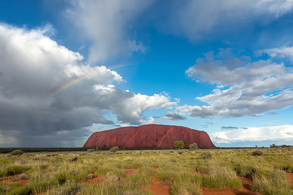 Dramatic clouds over Uluru in late afternoon
