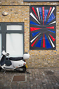 Queen's Park Union flag project - Eight leading designers have reinterpreted and redesigned the Union Jack for a project which imagines how the UK's flag could look. Set in place on the day of the Scottish Referendum, when the Union flag could be forced to change.  From Michiko Koshino's exploding, flame-shaped flag to Tim Dixon's shards, Georgina Goodman's 'heel's and Ron Arad's kinetic 'spinning flag', the flags represent a possible future look to the nation's flag. The Flag Project has been coordinated by Bill Amberg, designer based in Lonsdale Rd. The imagined new designs have been made up in Kvadrat material and will be on display within Lonsdale Road from 18 – 21 September as part of the London Design Festival. Kilburn, London, UK 18 Sept 2014.