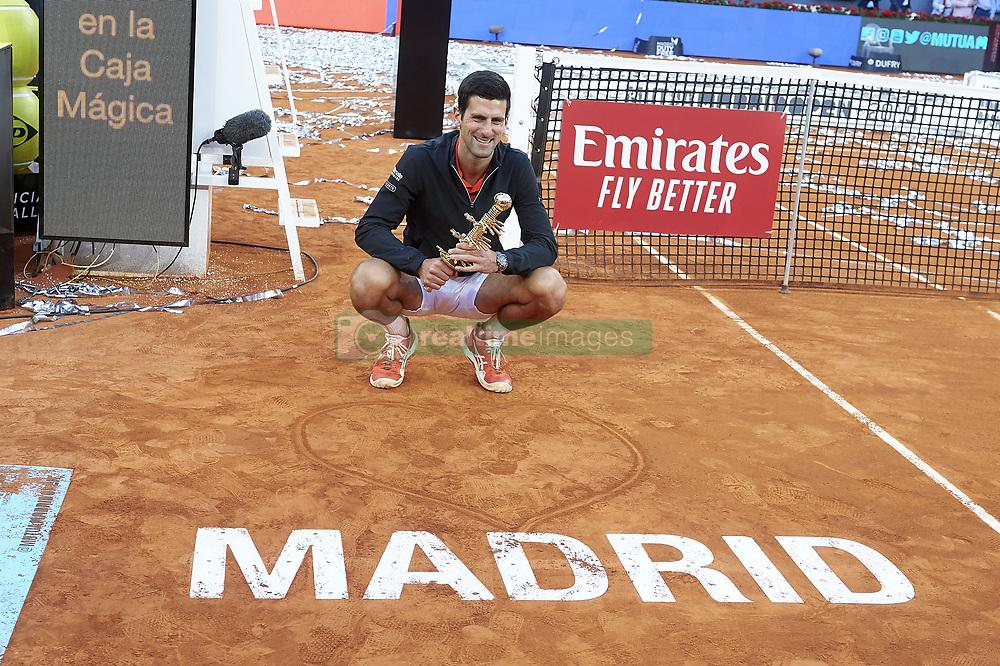 May 12, 2019 - Madrid, Spain - Serbian Novak Djokovic celebrating the championship after  ATP Singles Finals at Mutua Madrid Open in Madrid, Spain. May 12, 2019. (Credit Image: © Borjab.Hojas/NurPhoto via ZUMA Press)