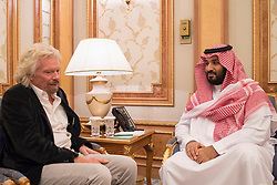 File Photo - Saudi Crown Prince Mohammad bin Salman, also known as MBS, (right) receives Sir Richard Branson in Riyadh, Saudi Arabia on October 26, 2017. A new Saudi anti-corruption body has detained 11 princes, four sitting ministers and dozens of former ministers, media reports say. The detentions came hours after the new committee, headed by Crown Prince Mohammed bin Salman, was formed by royal decree. Photo by Balkis Press/ABACAPRESS.COM  | 613893_002 Riyadh Arabie Saoudite Saudi Arabia