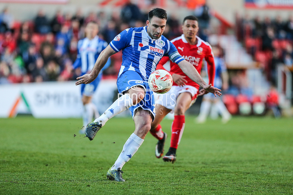 Wigan's Craig Morgan clears the ball during the Sky Bet League 1 match between Swindon Town and Wigan Athletic at the County Ground, Swindon, England on 25 March 2016. Photo by Shane Healey.
