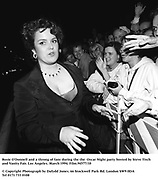 Rosie O'Donnell and a throng of fans during the the  Oscar Night party hosted by Steve Tisch and Vanity Fair. Los Angeles. March 1994. Film.94577/10<br />