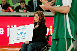 Telekom cheque for paraplegic sport mans during basketball match between KK Union Olimpija and Unics Kazan (RUS) of 10th Round in Group D of Regular season of Euroleague 2011/2012 on December 21, 2011, in Arena Stozice, Ljubljana, Slovenia. Unics Kazan defeated Union Olimpija 76:63.(Photo by Matic Klansek Velej / Sportida)