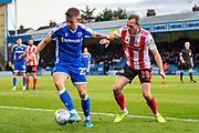 Gillingham FC midfielder Olly Lee  (22) and Sunderland  defender Laurens De Bock (28) during the EFL Sky Bet League 1 match between Gillingham and Sunderland at the MEMS Priestfield Stadium, Gillingham, England on 7 December 2019.