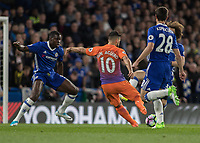Football - 2016 / 2017 Premier League - Chelsea vs. Manchester City<br /> <br /> Sergio Aguero of Manchester City  tries to squeeze his shot between the advancing Chelsea defence at Stamford Bridge.<br /> <br /> COLORSPORT/DANIEL BEARHAM