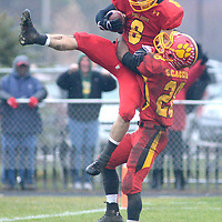 Laura Stoecker/lstoecker@dailyherald.com<br /> Batavia's Rouke Mullins is hoisted into the air by teammate Anthony Scaccia after scoring a touchdown in the third quarter over Lake Forest in the Class 6A quarterfinal on Saturday, November 16.