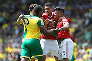 Tempers flare between Russell Martin of Norwich, Cameron Jerome of Norwich, Chris Smalling of Manchester United and Marcos Rojo of Manchester United during the Barclays Premier League match at Carrow Road, Norwich<br /> Picture by Paul Chesterton/Focus Images Ltd +44 7904 640267<br /> 07/05/2016