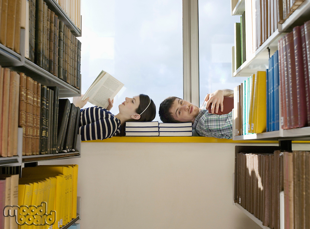 Two College Students Reading in Library