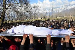 March 22, 2019 - Srinagar, Kashmir, India - Kashmiri people carry the dead body of an 11 year old civilian boy Atif Mir who was killed during a gun battle between Indian Government forces and suspected foreigner Militants in Hajin area of Bandipora district, Indian Administered Kashmir on 22 March 2019. Indian government forces have killed 8 rebels in 4 separate gunfights across Kashmir. Atif was killed after he was allegedly kept hostage by militants during gunfight, police said. (Credit Image: © Muzamil Mattoo/NurPhoto via ZUMA Press)