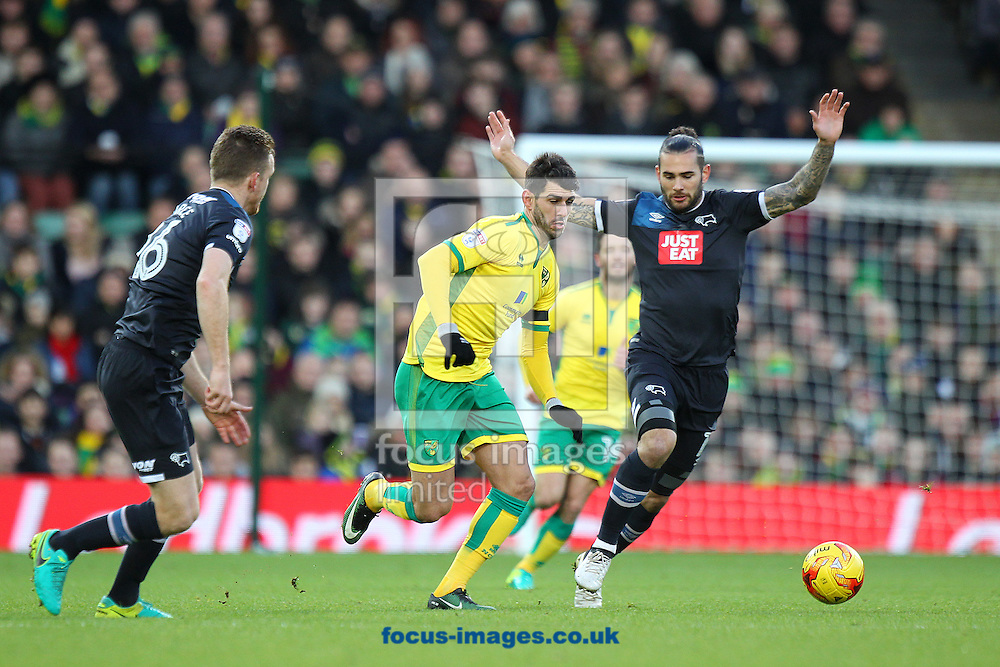 Nelson Oliveira of Norwich and Bradley Johnson of Derby County in action during the Sky Bet Championship match at Carrow Road, Norwich<br /> Picture by Paul Chesterton/Focus Images Ltd +44 7904 640267<br /> 02/01/2017