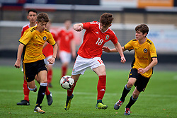 MERTHYR TYDFIL, WALES - Thursday, November 2, 2017: Wales' Callum Flynn and Newport County's Ryan George during an Under-18 Academy Representative Friendly match between Wales and Newport County at Penydarren Park. (Pic by David Rawcliffe/Propaganda)
