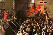 """EU-LAC Summit (Meeting of EU and Latin American Heads of State)..Hugo Cha?vez, controversial President of Venezuela, and Aleida Guevara, Che Guevara's daughter, take part in the podium discussion """"Ha?nde weg von Venezuela & Kuba!!!"""" (Hands off Venezuela & Cuba) at the Arena, Vienna. Youngsters waving flags with an image of Che Guevara."""