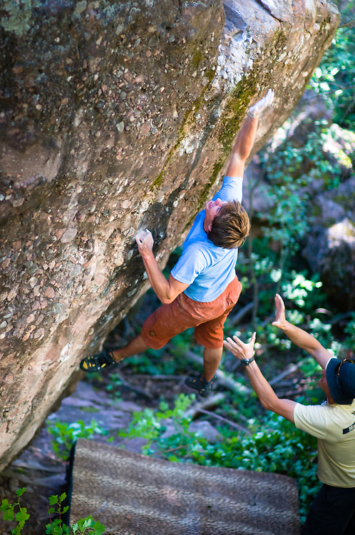 Ben Rueck gives his all on an un-named and un-climbed boulder problem in Redstone, CO.
