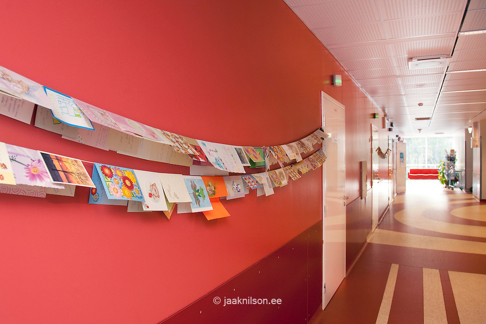 cards and posters hung on the wall in women`s clinic