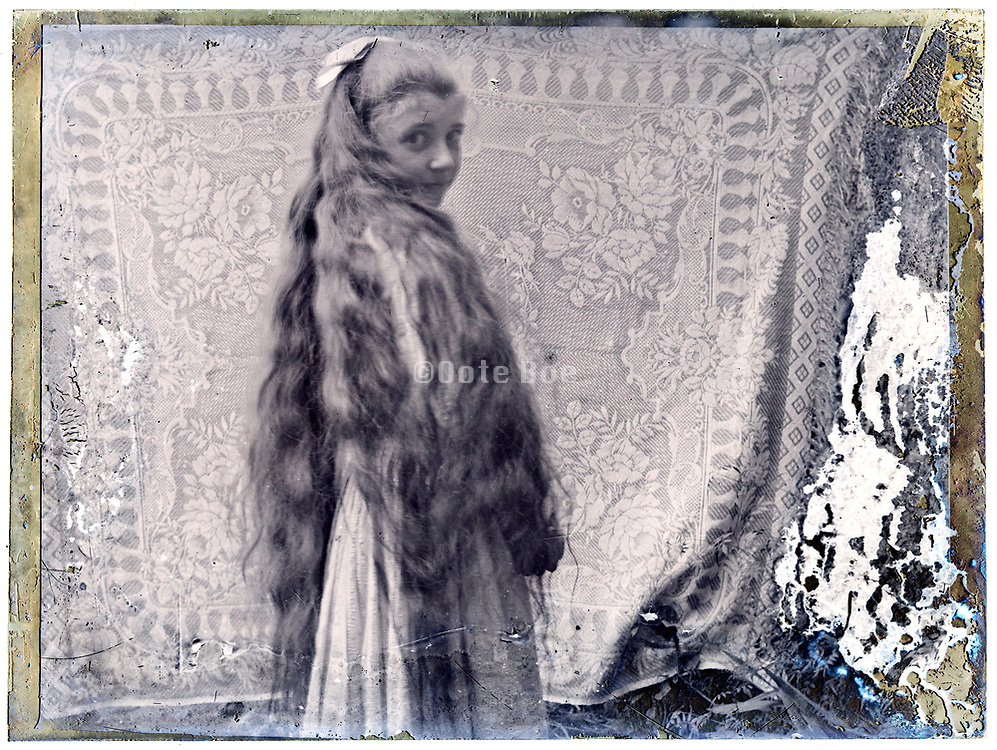 deteriorating portrait image of a young girl with very long hair  early 1900s