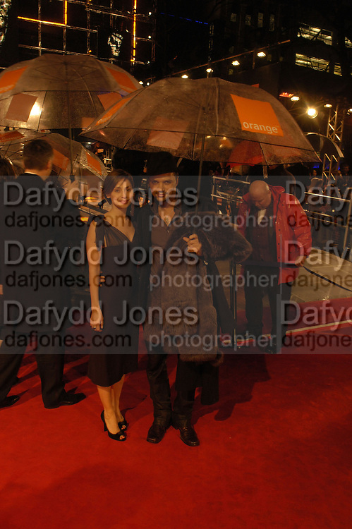 Natalie Imbruglia and Mohieb. arrive at the 2006 BAFTA Awards at the Leicester Square Odeon Cinema in London. 19 February 2006.  -DO NOT ARCHIVE-© Copyright Photograph by Dafydd Jones 66 Stockwell Park Rd. London SW9 0DA Tel 020 7733 0108 www.dafjones.com