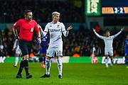 Leeds United defender Gjanni Alioski (10) reacts to Tony Harrington (Referee) during the EFL Sky Bet Championship match between Leeds United and Cardiff City at Elland Road, Leeds, England on 14 December 2019.