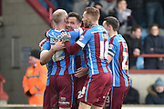 Scunthorpe celebrate Tom Hopper of Scunthorpe United scoring his second goal to go 6-0 up  during the Sky Bet League 1 match between Scunthorpe United and Swindon Town at Glanford Park, Scunthorpe, England on 28 March 2016. Photo by Ian Lyall.