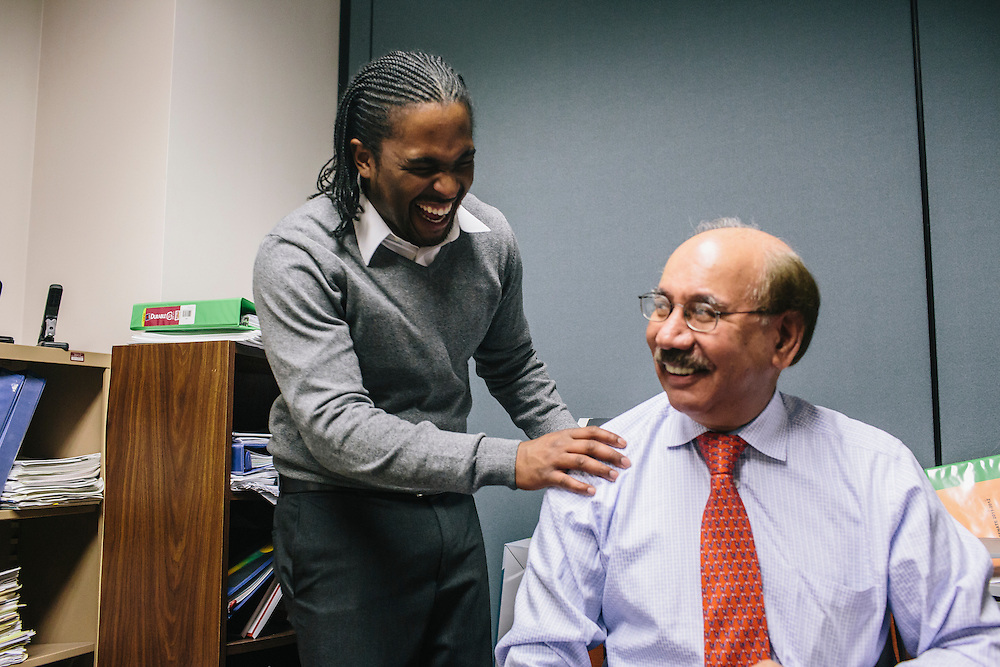 Dr. Daryao Khatri, a physics and computer science professor at University of Washington DC, jokes with former student Marc Davis in Dr. Khatri's office. Dr. Khatri mentored Davis and has become a father figure to him. Now, the two spend a little time together every day working through physics problems or simply catching up with each other.