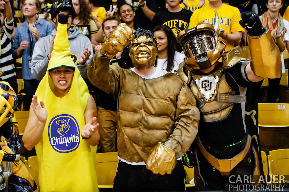 November 13th, 2013:  The Colorado Buffaloes CUnit fans celebrate a  63-58 win over non-conference rival Wyoming at the conclusion of the NCAA Basketball game between the University of Wyoming Cowboys and the University of Colorado Buffaloes at the Coors Events Center in Boulder, Colorado