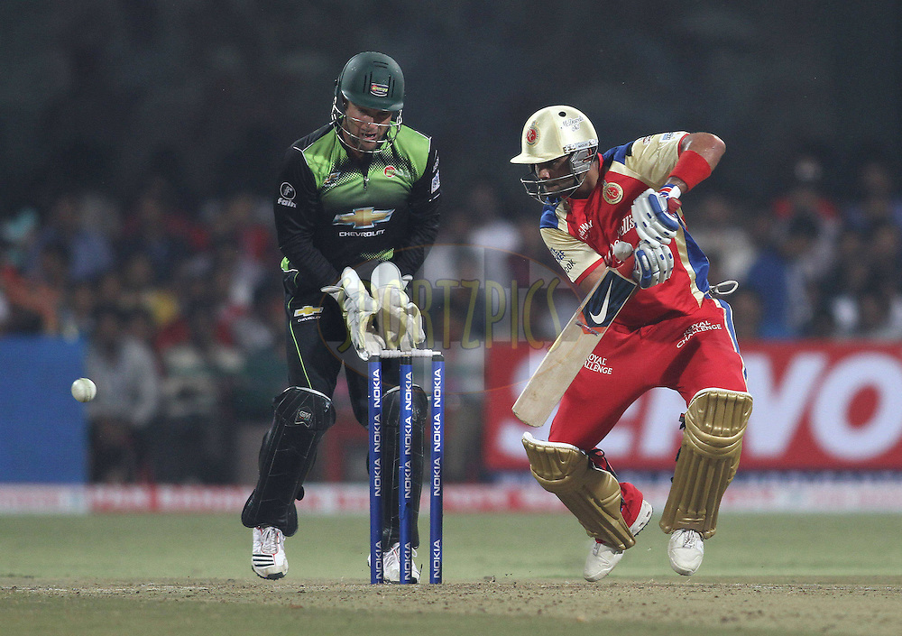 Virat Kohli of Royal Challengers Bangalore pushes a delivery square during match 1 of the NOKIA Champions League T20 ( CLT20 )between the Royal Challengers Bangalore and the Warriors held at the  M.Chinnaswamy Stadium in Bangalore , Karnataka, India on the 23rd September 2011..Photo by Shaun Roy/BCCI/SPORTZPICS