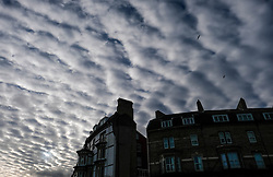 © Licensed to London News Pictures. <br /> 10/01/2017. <br /> Saltburn by the Sea, UK.  <br /> <br /> Altocumulus Undulatus cloud formations can be seen over Saltburn by the Sea.<br /> <br /> The wave like pattern is caused by the way the winds vary with altitude and blow at different speeds above and below the cloud layer.<br /> <br /> <br /> Photo credit: Ian Forsyth/LNP