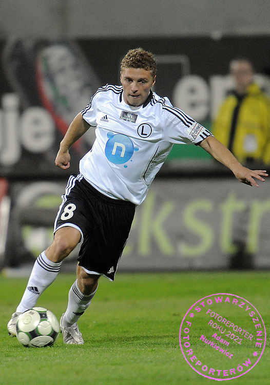 MACIEJ IWANSKI (LEGIA) CONTROLS THE BALL DURING EXTRALEAGUE SOCCER MATCH BETWEEN LEGIA WARSAW AND LECH POZNAN DURING 8. ROUND SEASON 2009/2010...WARSAW , POLAND , SEPTEMBER 25, 2009..( PHOTO BY ADAM NURKIEWICZ / MEDIASPORT )..PICTURE ALSO AVAIBLE IN RAW OR TIFF FORMAT ON SPECIAL REQUEST.