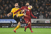 Wolverhampton Wanderers Johnny Otto battles with Liverpool forward Mohamed Salahduring the Premier League match between Wolverhampton Wanderers and Liverpool at Molineux, Wolverhampton, England on 21 December 2018.
