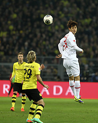 25.01.2014, Signal Iduna Park, Dortmund, GER, 1. FBL, Borussia Dortmund vs FC Augsburg, 18. Runde, im Bild Dong-Won Ji (FC Augsburg #24), Kopfball, Marcel Schmelzer (Bor Dortmund), Aktion, Zweikampf, Hochformat, hoch, vertikal // during the German Bundesliga 18th round match between Borussia Dortmund and FC Augsburg at the Signal Iduna Park in Dortmund, Germany on 2014/01/26. EXPA Pictures &copy; 2014, PhotoCredit: EXPA/ Eibner-Pressefoto/ Krieger<br /> <br /> *****ATTENTION - OUT of GER*****
