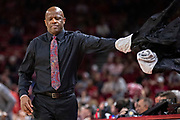 FAYETTEVILLE, AR - MARCH 9:  Head Coach Mike Anderson of the Arkansas Razorbacks takes off his jacket during a game against the Alabama Crimson Tide at Bud Walton Arena on March 9, 2019 in Fayetteville, Arkansas.  The Razorbacks defeated the Crimson Tide 82-70.  (Photo by Wesley Hitt/Getty Images) *** Local Caption *** Mike Anderson
