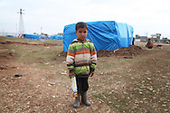 ARBAT, IRAQ: Hamza Tallal, 4, from Derzor, Syria, is pictured in a refugee camp in Arbat, Iraq. ..The semi-autonomous region of Iraqi Kurdistan has accepted refugees from the conflict in Syria into several camps. Arbat lies near Sulaimaniyah in northeastern Iraq, approximately 500 kilometres from the Syrian border...Photo by Besaran Tofiq/Metrography