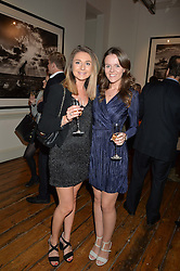 Left to right, LUCY YARROW niece of David Yarrow and ALISON MacLELLAN at a private view of photographs by renowned wildlife photographer David Yarrow in aid of TUSK entitled 'Wild Encounters' held at Somerset House on 19th September 2016.