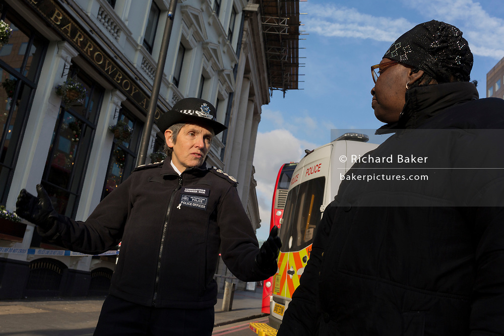 The morning after the terrorist attack at Fishmongers Hall on London Bridge, in which Usman Khan (a convicted, freed terrorist) killed 2 during a knife a attack, then subsequently tackled by passers-by and shot by armed police - Met Police Commissioner Cressida Dick speaks with a local lady before touring Borough Market, on 30th November 2019, in London, England.