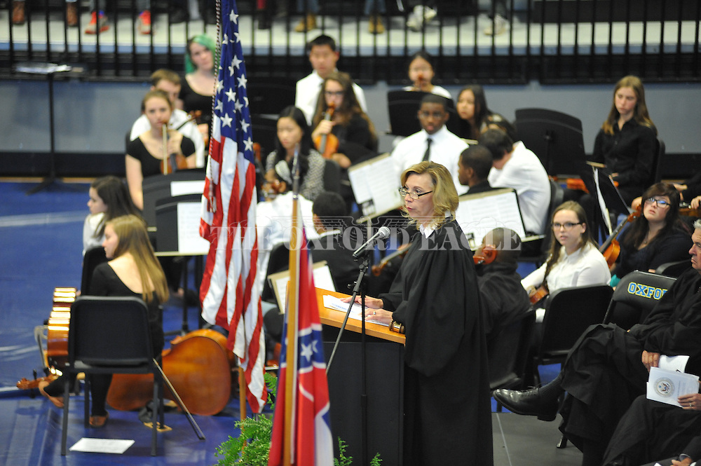 Judge Sharion Aycock speaks during a Naturalization Ceremony in U.S. District Court for the Northern District of Mississippi, at Oxford High School in Oxford, Miss. on Tuesday, November 18, 2014. The ceremony was the first the court has ever held at the school.